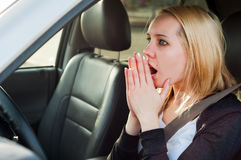 Female driver  panic in a car Stock Image