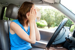 Female driver  panic in a car Stock Images