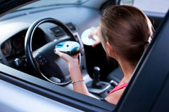 Female driver playing music in the car Royalty Free Stock Image