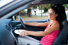 Female driver playing music in the car Stock Photography
