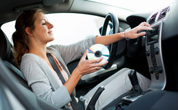 Female driver playing music in the car Royalty Free Stock Photography