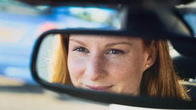 Female Driver in the Rear View Mirror Stock Photo