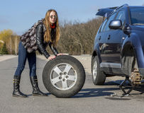 Female driver repairs car Stock Photography