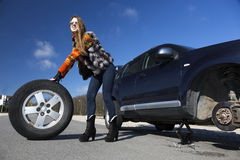 Female driver repairs car Stock Images