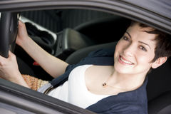 Female Driver Seated In Black Sport Sedan Auto Stock Images