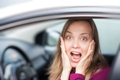 Female driver shocked Stock Images