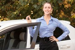 Female driver showing car key Royalty Free Stock Photo