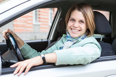 Female driver sitting in car and holding wheel Royalty Free Stock Photo