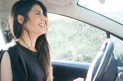 Female driver in a sunny day Royalty Free Stock Photo