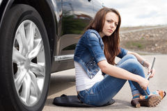 Female driver waiting for roadside assistance Royalty Free Stock Images