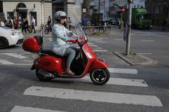 FEMALE DRIVES SCOOTER Stock Photo