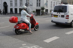 FEMALE DRIVES SCOOTER Stock Photography