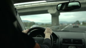 Female drives under the bridge in slo-mo stock video footage