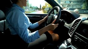 Female driving car in reverse gear, looking for parking lot, attentive driver stock photos