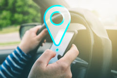 Female driving car and using gps navigation app on smartphone Stock Photo