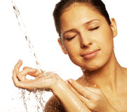 Female with a drops of water on her pure face Royalty Free Stock Photos