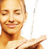 Female with a drops of water on her pure face Royalty Free Stock Images