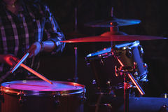 Female drummer playing drum set in nightclub Royalty Free Stock Photo