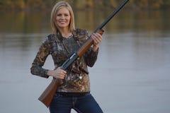 Female Duck Hunter. A female duck hunter with her shotgun stock photography