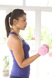 Female with dumbbell Stock Photo