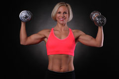 Female with dumbbells Stock Photos