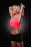 Female with dumbbells Stock Images