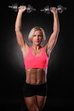 Female with dumbbells Stock Photography