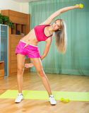 Female with dumbbells at home Royalty Free Stock Photography