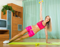 Female with dumbbells at home Royalty Free Stock Photos
