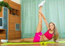 Female with dumbbells at home. Smiling sporty young woman training with dumbbells at home Stock Photo