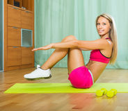 Female with dumbbells at home Royalty Free Stock Images