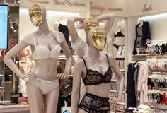 Female dummies with gold faces in lacy underwear.  stock image