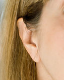 Female Ear. Pinna or auricle is the outer part of the human ear Royalty Free Stock Photography