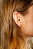 Female ear close-up Royalty Free Stock Photos