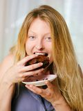 Female eating a brownie Royalty Free Stock Images