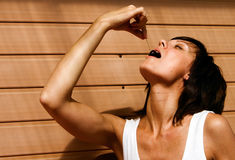 Female Eating Cherry Stock Photo