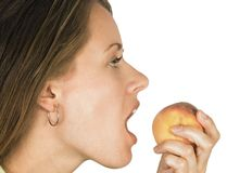 Female eating food. A woman is just about to eat some fruit Royalty Free Stock Photo