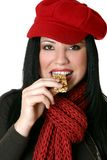Female eating healthy nut bar Stock Image
