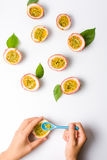 Female eating Passion fruit with a spoon Royalty Free Stock Images
