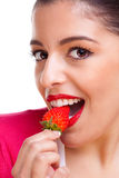 Female eating strawberry Royalty Free Stock Photography