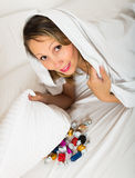 Female eating sweets in bed Royalty Free Stock Photo