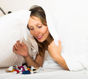 Female eating sweets in bed Stock Photos
