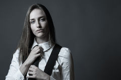 Female Editorial On Masculinity. Slender caucasian female editorial style portrait of masculinity Royalty Free Stock Image