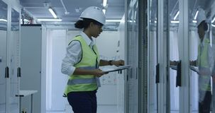 Female electrical worker reading paperwork stock video footage