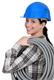 Female electrician. Stood with coiled wiring Royalty Free Stock Photo