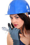 Female electrician. Seductive female electrician wearing a blue hard hat Royalty Free Stock Image
