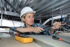 Female electrician with cables. Woman Stock Photo