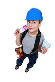 Female electrician with cash. Female electrician with lots of cash Stock Photo