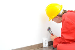 Female electrician fixing electricity problem Royalty Free Stock Photos