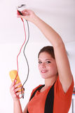 Female electrician fixing  lighting Stock Images